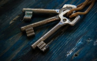3 older keys on a chain