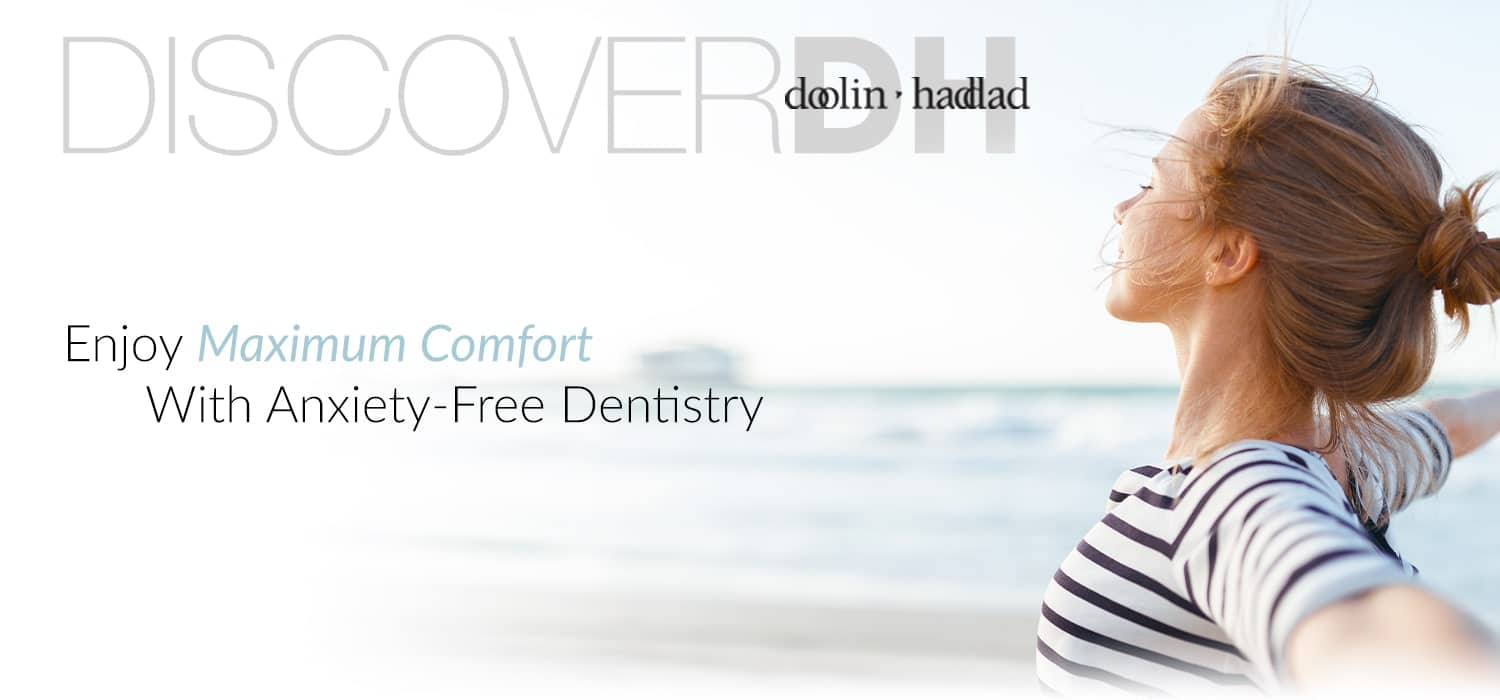 "Banner with a woman standing and stretching on the beach with the words ""Enjoy maximum comfort with anxiety-free dentistry"""