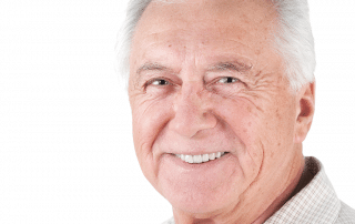 Older man smiling after having a non-surgical facelift