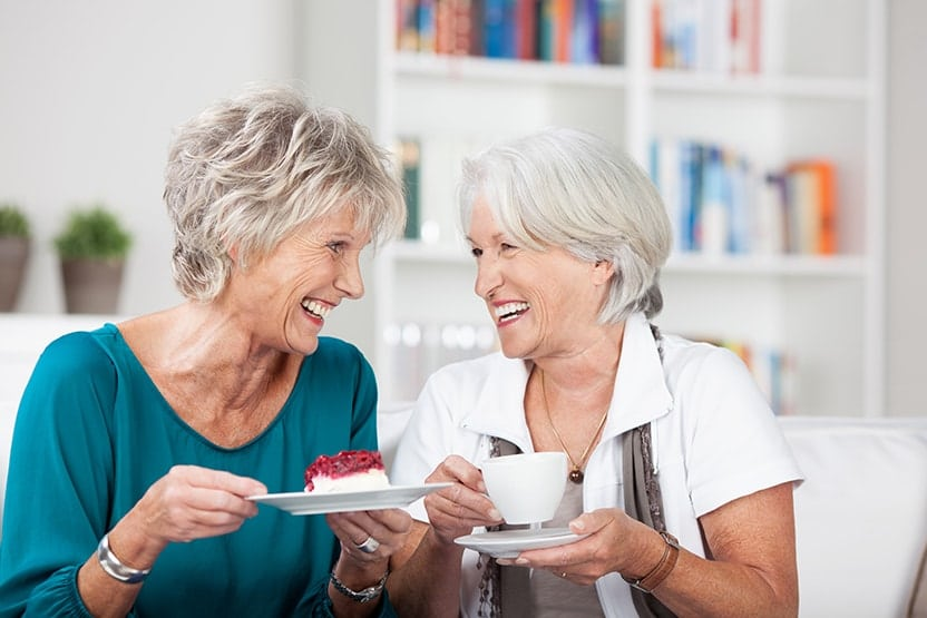 Old friends laughing together while drinking coffer. While there are many benefits to drinking coffee, it's also unfortunately true that coffee could be making our smiles look old(er) than some of your friends.