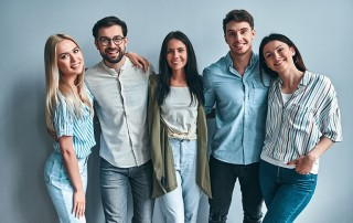 A group of 5 friends with unique smiles. Just like them here are 5 things you need to know about Invisalign.