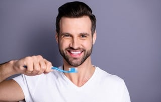 attractive man prepares to brush his teeth